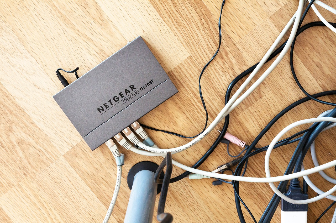 image: router with leads on a wooden floor