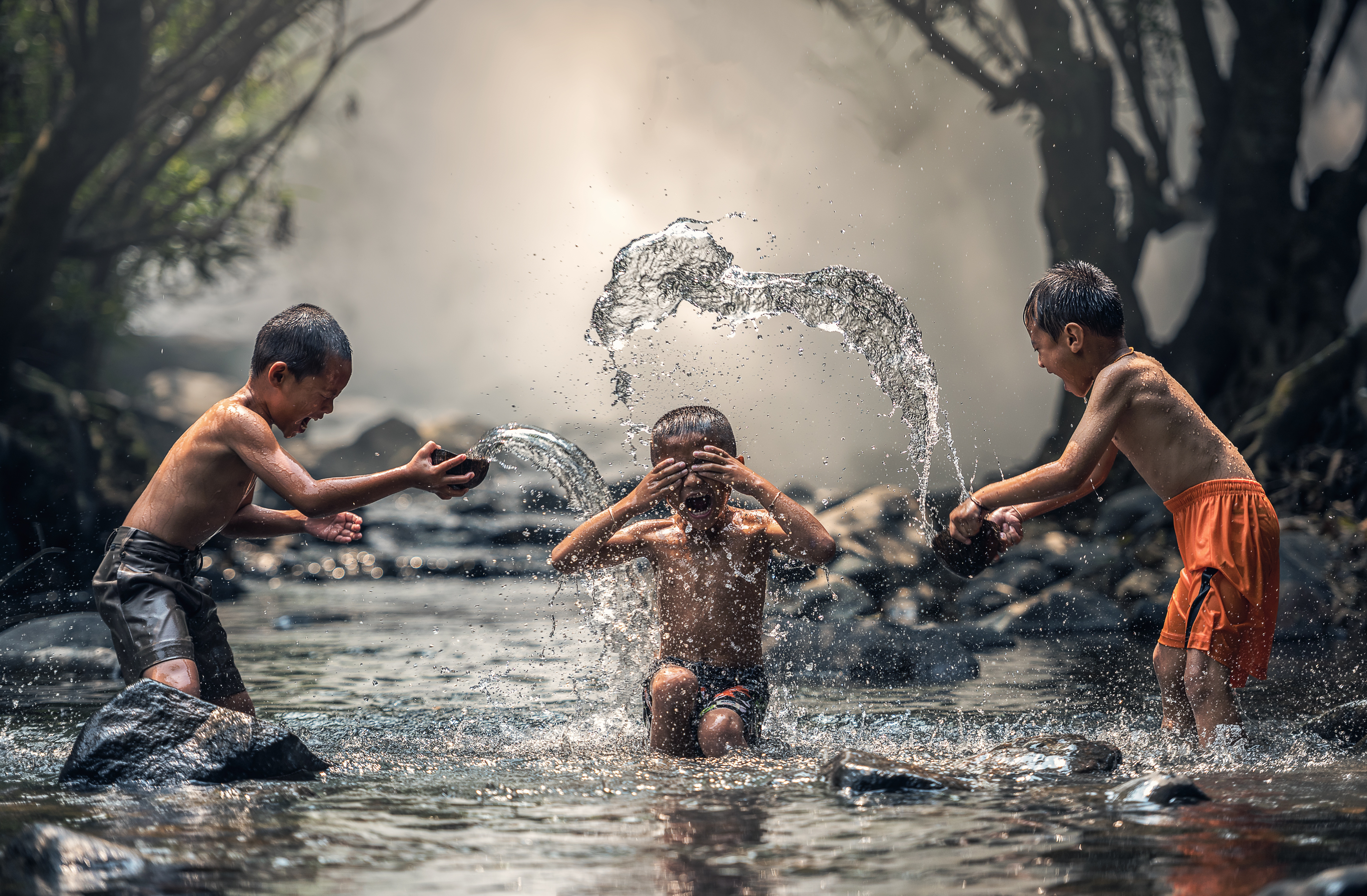 Image: Children playing in a pond