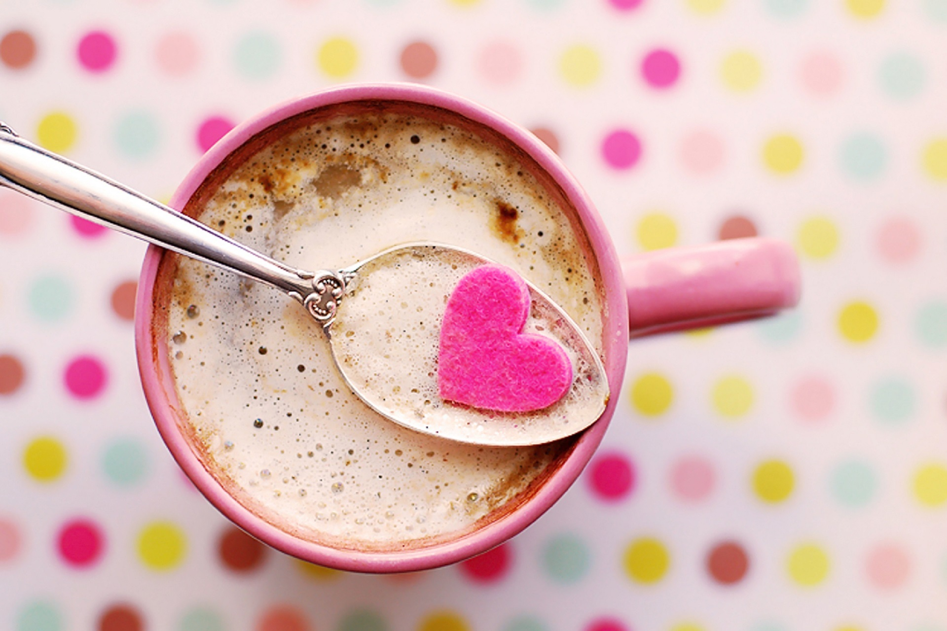Image: Frothy coffee with heart on a spoon