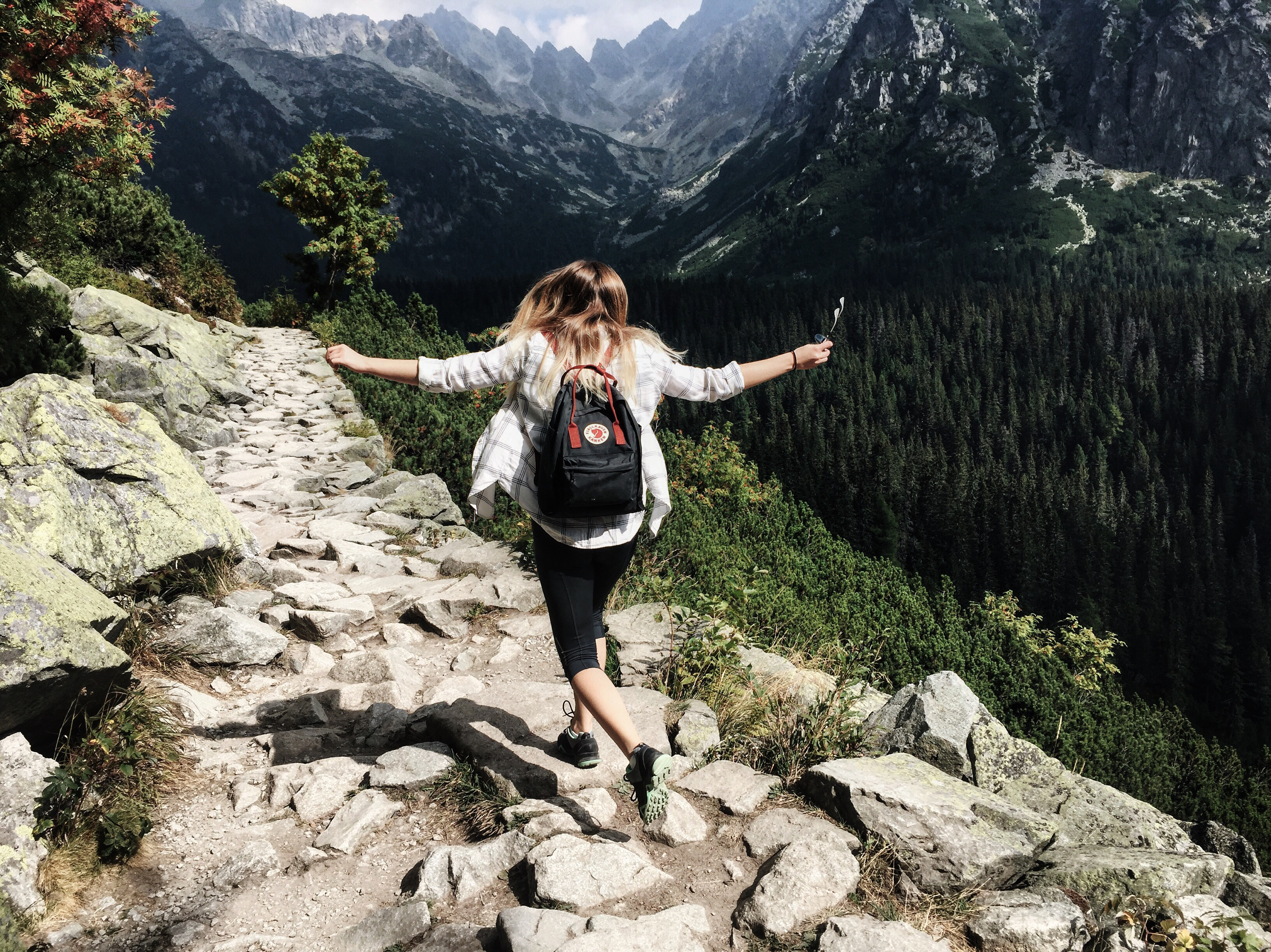 Image: Young Woman hiking in mountains