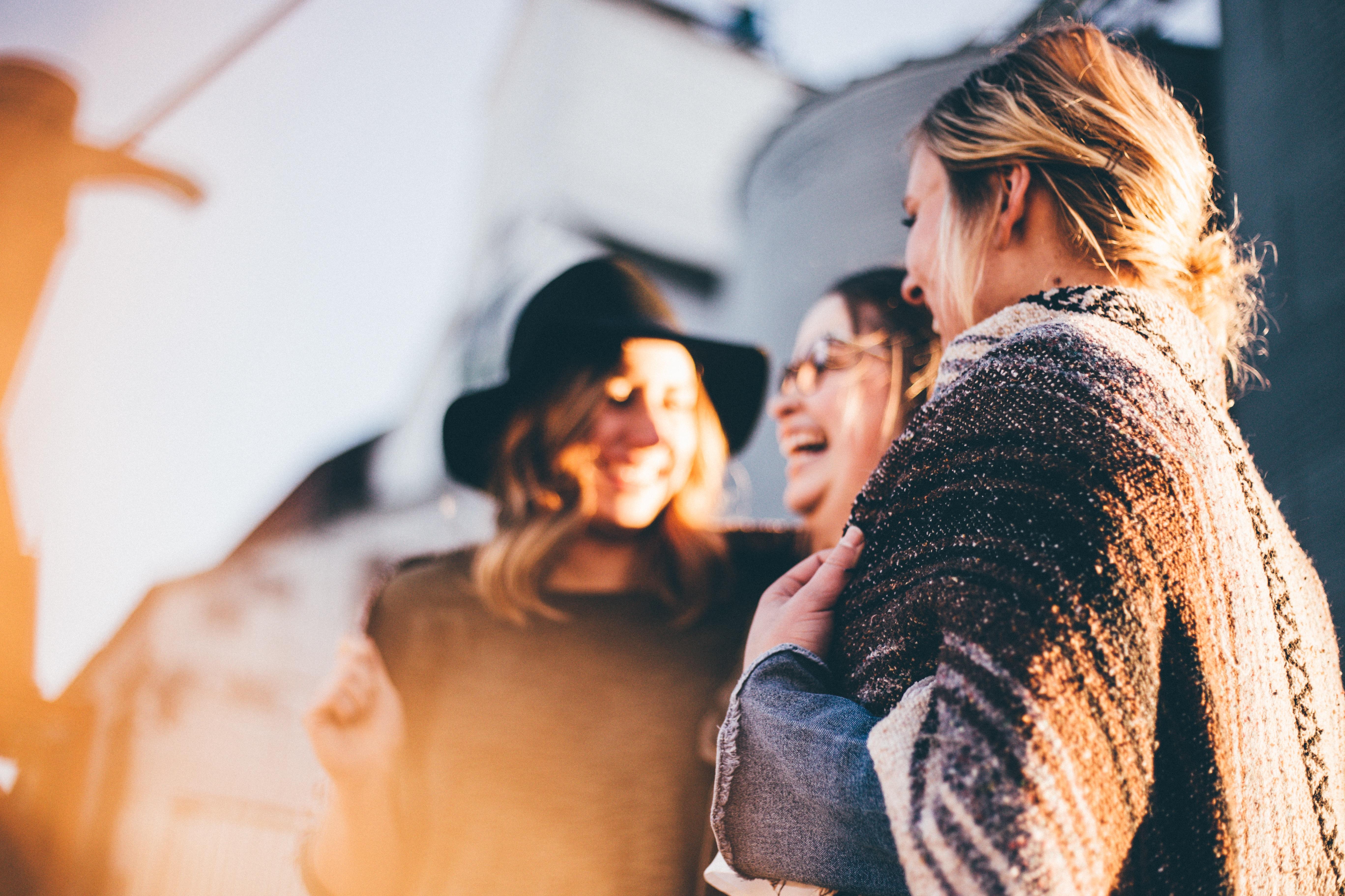 Image: three woman laughing