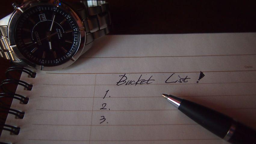 image: bucket list paper pen and watch